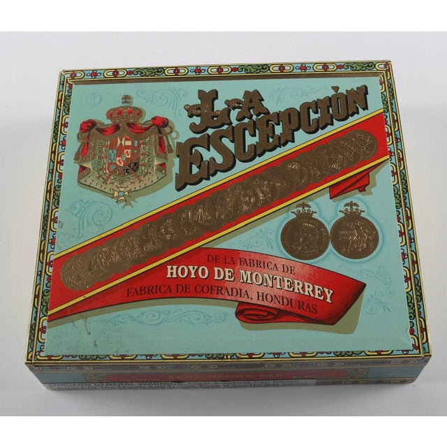 A collection of vintage La Escepción cigar boxes. This collection includes ten cigar boxes. These would be great on a...
