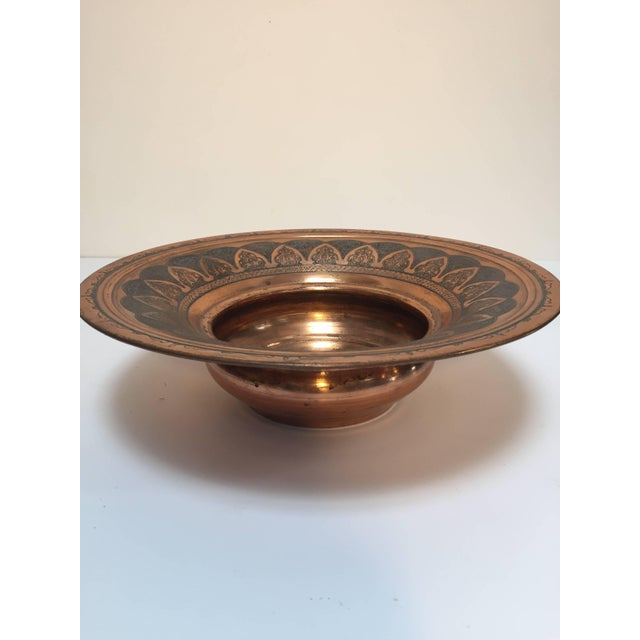 Handcrafted antique 19th century copper Middle Eastern ewer with basin. The ewer with a rounded body, on short splayed...