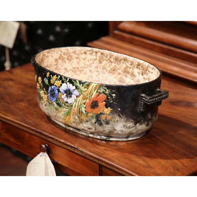 Elegant and colorful antique planter from Central France; hand painted in Montigny sur Loing, circa 1920, the jardiniere...