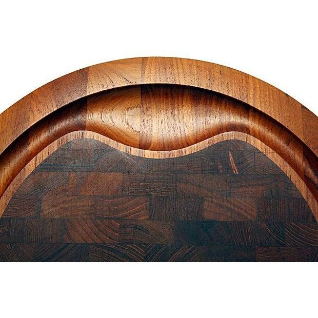 Rare, oversize Dansk staved teak cheese serving board with sculptural hand hold and elegantly sloped edge detailing....