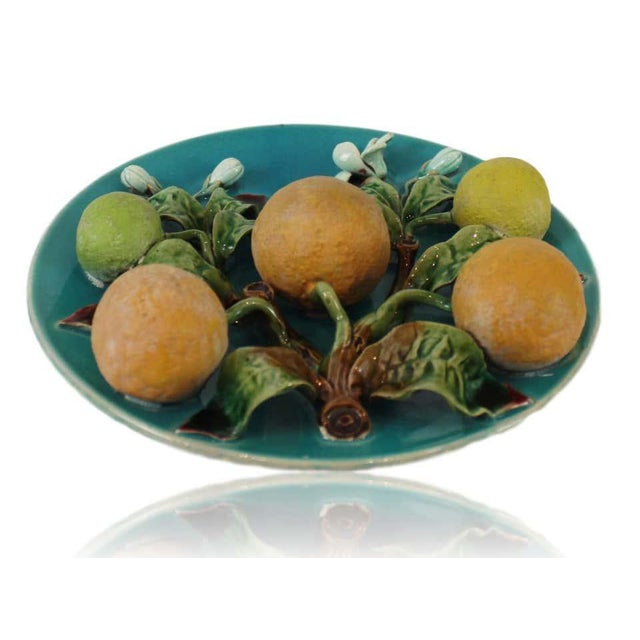 Menton French Majolica Barbotine wall plaque on a turquoise ground with oranges molded in high relief, circa 1880,...