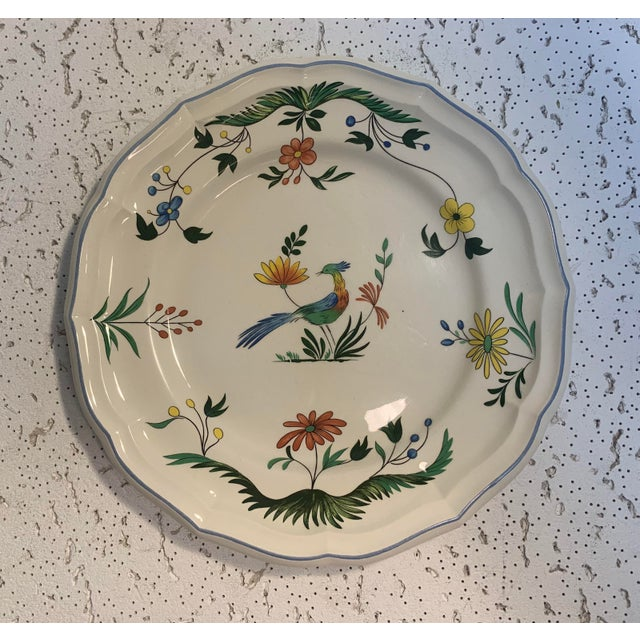 Beautifully designed set of 3 Gien, France plates. Floral pattern with bird at center of plate. Blue lining around the...