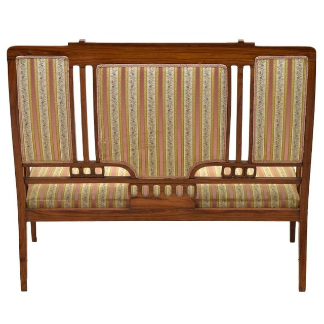 This Art Nouveau sofa is true to the era as it incorporates both geometric shapes and organic patterns. What is really...
