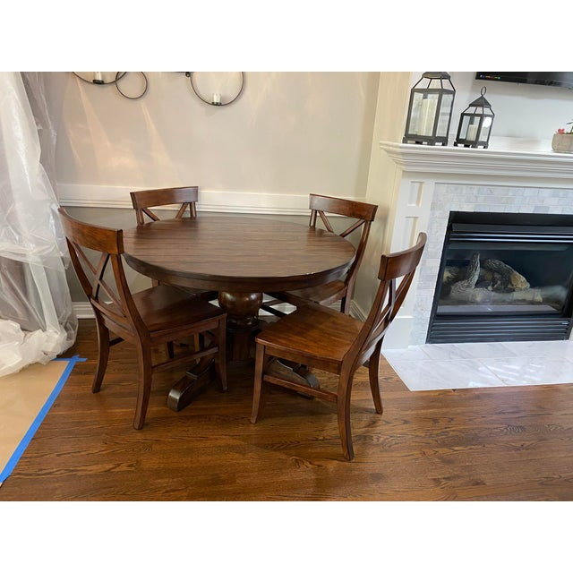 Lorraine Round Pedestal Extending Dining Table -Rustic Brown. Frame-and-panel construction and an elegantly turned...