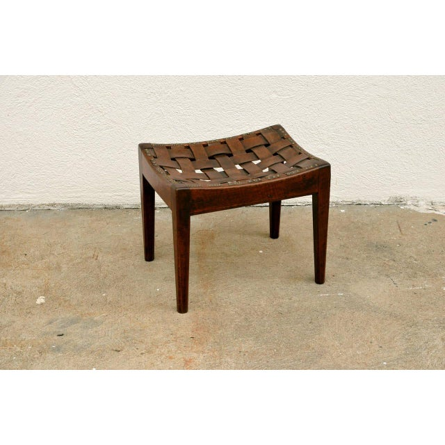 Small English arts and crafts stool by the celebrated Cumbrian designer and craftsman Arthur Simpson of Kendal. Oak frame...