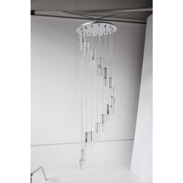 """Wonderful fifteen light chandelier with cascading heavy glass pendants suspended by wire in a dramatic 60"""" downward spiral."""