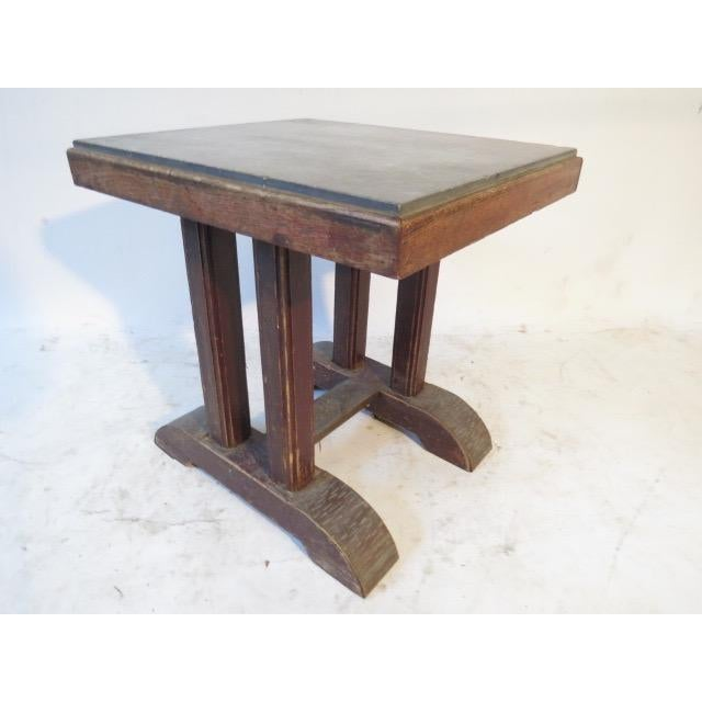 This vintage table dates to about 1920. Features a marble top and beech wood frame.