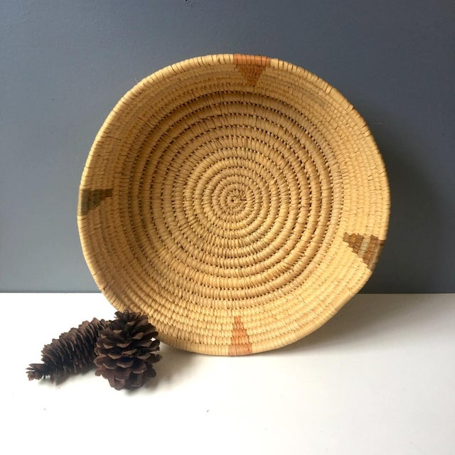 Vintage coiled basket for storage or decor. Light raffia woven with four colored points spaced around the sides. Jungalow...