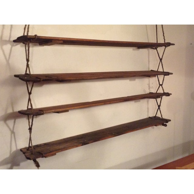 A 1950's set of hanging shelves constructed from reclaimed barnwood siding and rope. Shelves can be repositioned and...