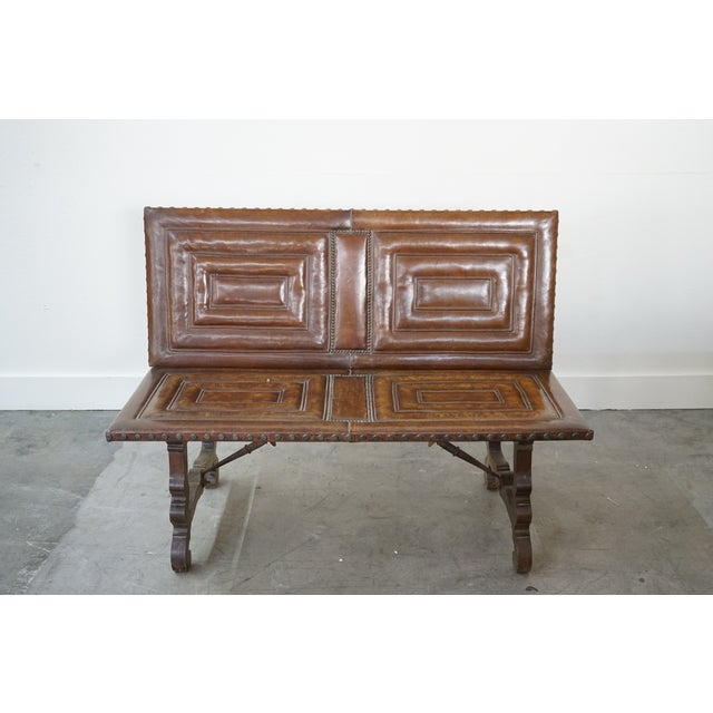 You are looking at a handsome 20th century French unique embossed leather bench with nailhead trim and beautifully carved...