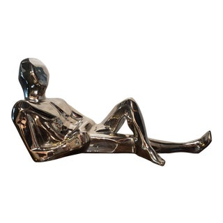 Modernist Ceramic Chrome Finish Reclining Man Sculpture by Jaru For Sale