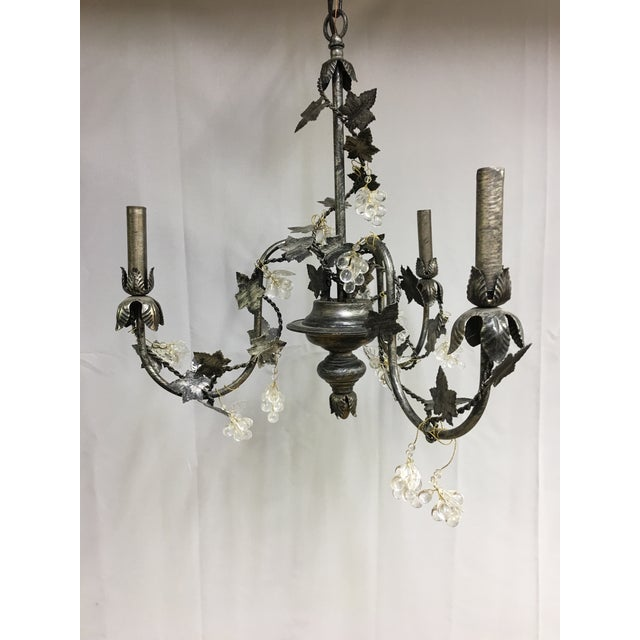 Petite 3 arm chandelier by John Richard. This chandelier is decorated with grapevines in black, silver and gray, with...