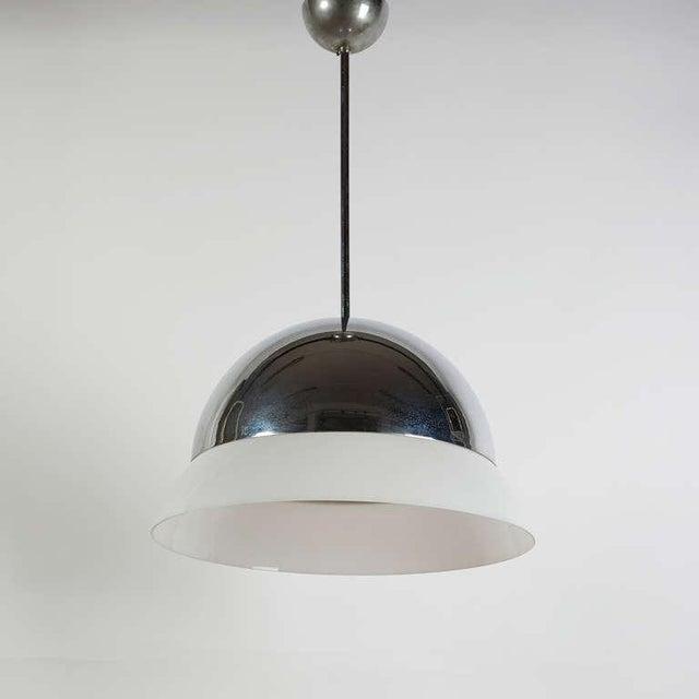 "Rare chromed version of ""Cirene"" pendant lamp by Vico Magistretti for Artemide. Chromed brass frame and opaline glass shade."