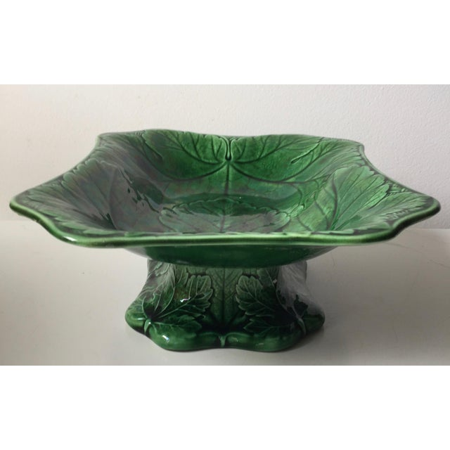 This stunningly beautiful and rare example of antique English Wedgwood Majolica is a large green grape leaf design footed...