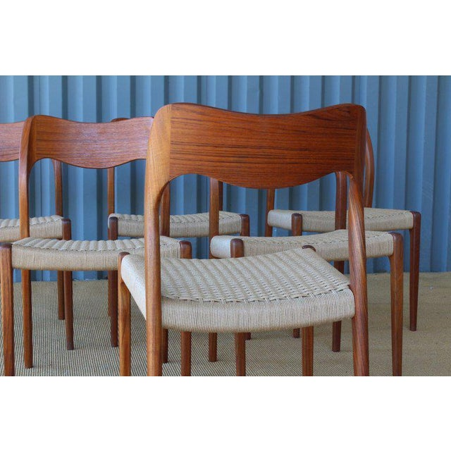 Set of six teak dining chairs by Niels Moller. The entire set of six has been completely refinished including new woven...