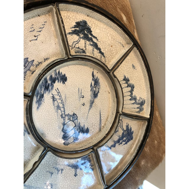 Wonderful lazy susan type paper mache tray with blue and white porcelain dishes in side. Center Dish with six surrounding...