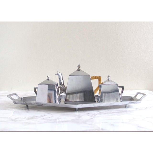 Antique 1920's art deco tea service in excellent condition. Very Bauhaus-influenced angular geometric style. Silverplated...