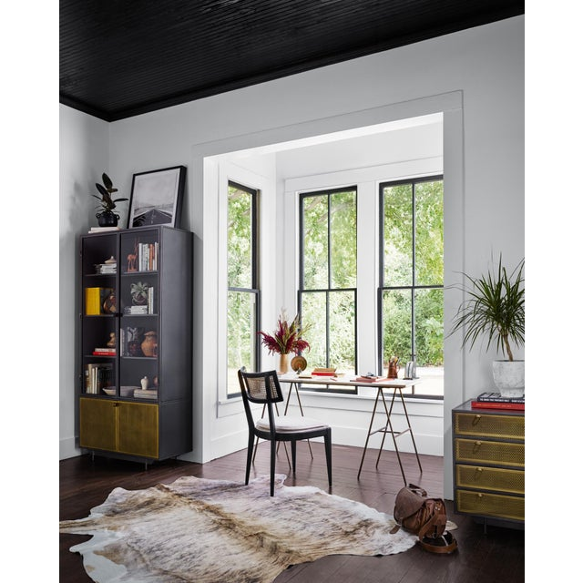 Simple A framing gets a sophisticated spin. Matte brass-finished iron offers a slender, open look, as polished white...