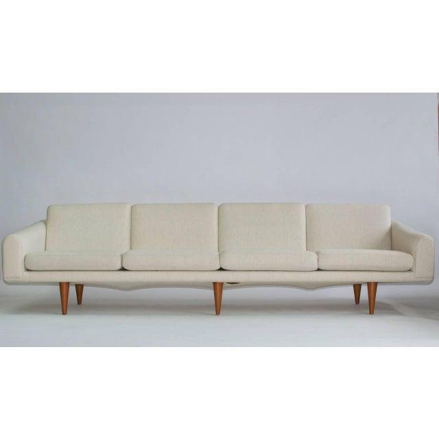 Illum Wikkelsø sofa. Round tapered solid teak legs. Recently upholstered. Wool fabric.