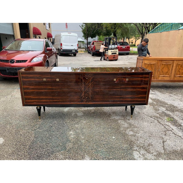 Beautiful French Art Deco exotic Macassar ebony mother of pearl center sideboard or buffet, circa 1940s. This piece...