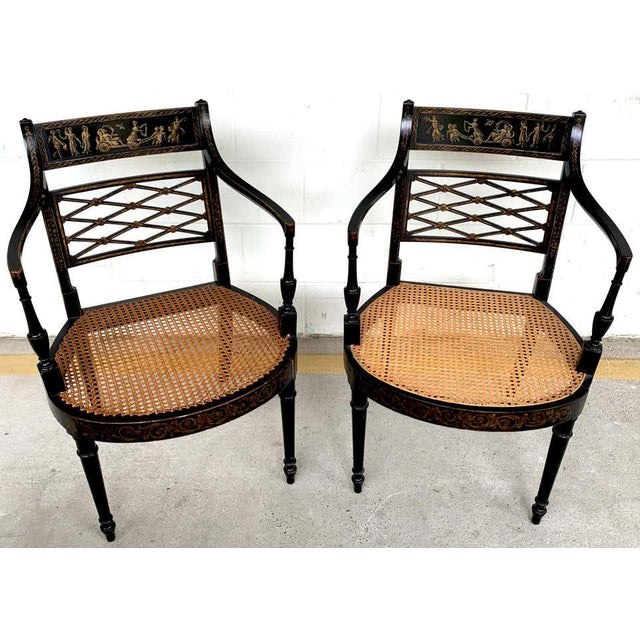 Pair of Regency black and polychrome cane seat armchairs, each one beautifully painted and gilt with classical scenes,...
