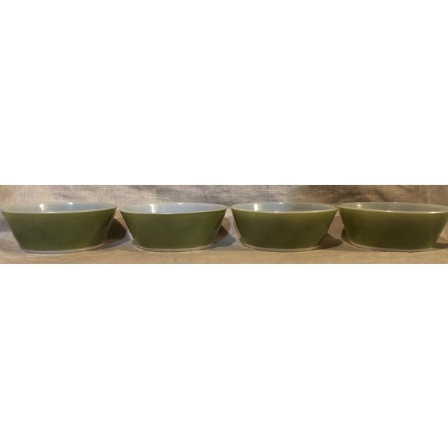 Set of four Federal cereal bowls in avocado green. Good condition with very few fleabites to paint and one scratch to one...
