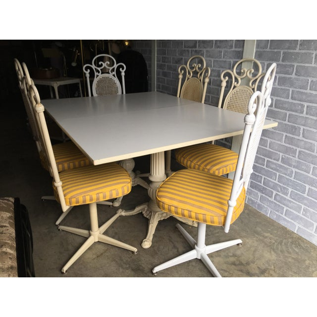 A vintage lightweight cast iron dining set. The set of six chairs are newly upholstered in a yellow stain resistant...