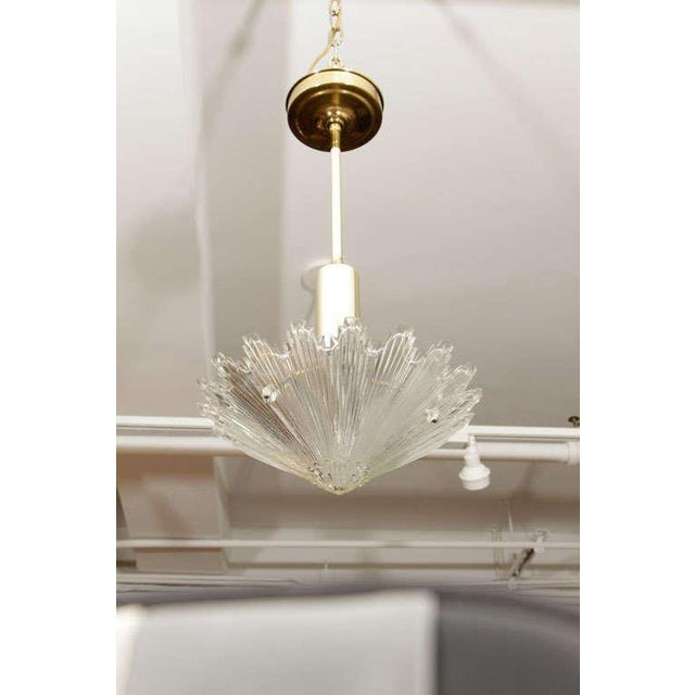 A lovely pair of hanging lights with a molded glass flower shaped bowl suspended from a brass rod perfect for a kitchen,...