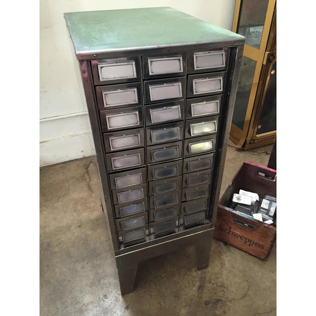 One-of-a-kind, up-cycled and polished to a sexy sheen, this 30-drawer free-standing vintage index cabinet is as fabulous...