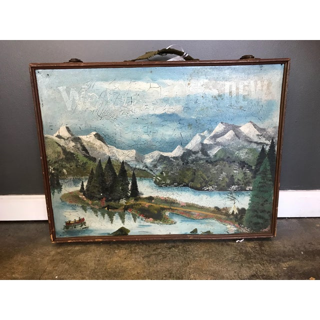 A Charming Vintage Wooden Artist's box with two different painted scenes, one on each side. One side has a winter scene...