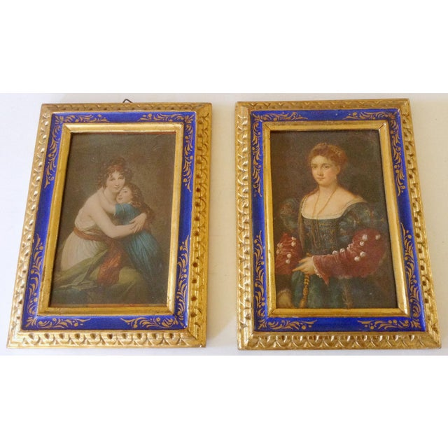 This pair of lovely Italian frames in royal blue and gold hold prints of famous pieces of European art. One is by Vigée Le...