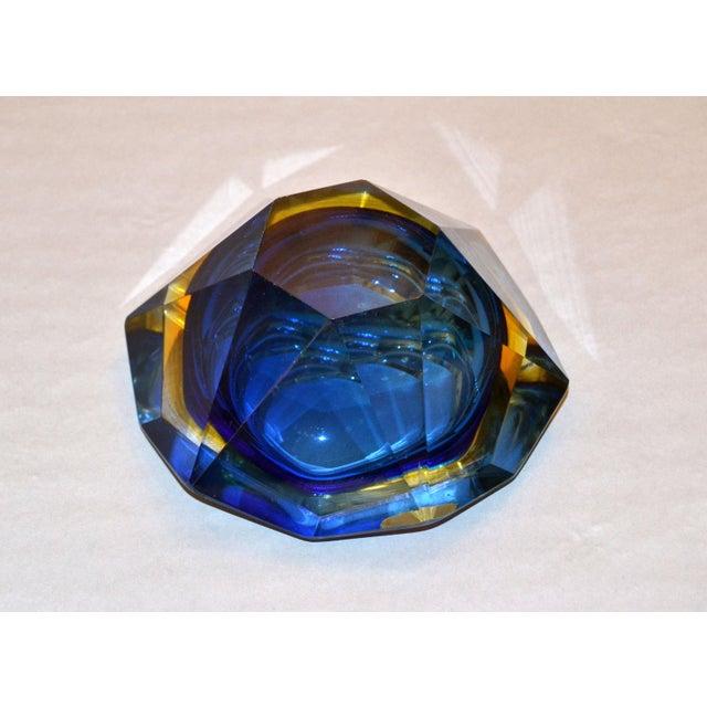 Multi faceted blue, yellow and clear Murano glass ashtray, glass bowl attributed to Flavio Poli by V.A.M. Vetri Molati...