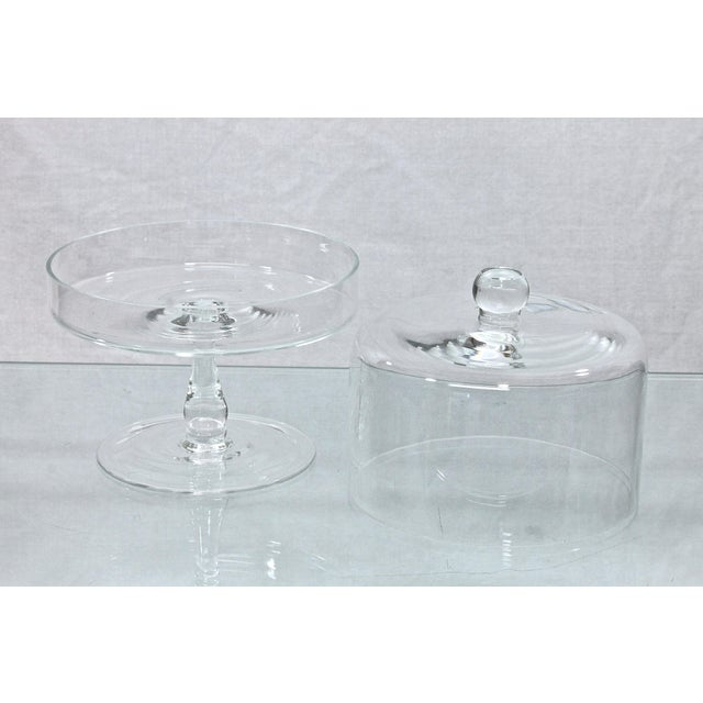 Lovely glass stand with dome, excellent for petit fours or mini parties. In excellent condition with no chips to cracks.