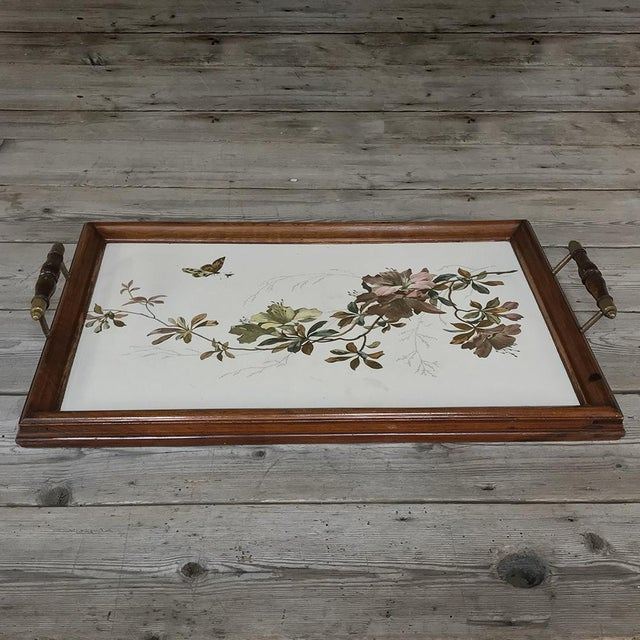 Antique Hand-Painted Tile Serving Tray features a wooden frame with hand-painted tiles for a beautiful yet carefree...