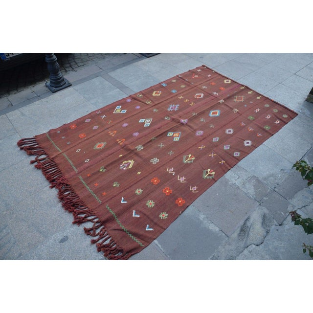 Turkish vintage handwoven kilim rug from Anatolian wool on wool. Good condition for use.