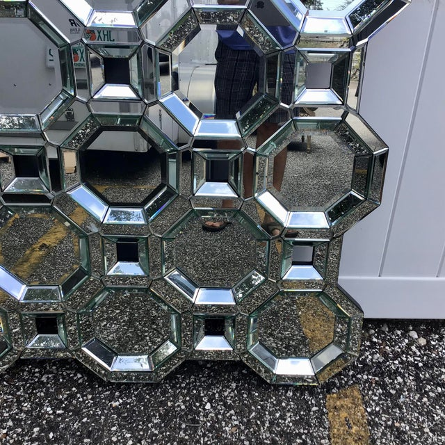 This rectangular art deco styled mirror features a 3-D mosaic of 15 large octagonal mirrors with deeply beveled mirrored...