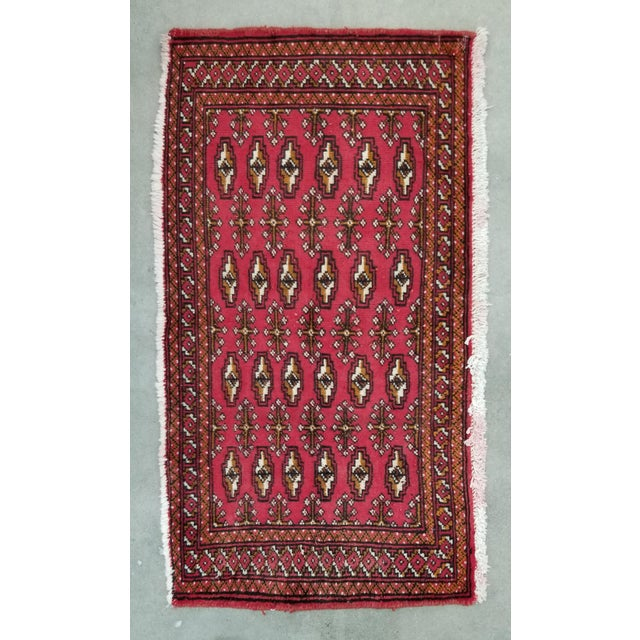 This is a TURKAMAN Persian rug from the 1950's. It showcases the beautiful medallion and bush pattern (bukhara design)...