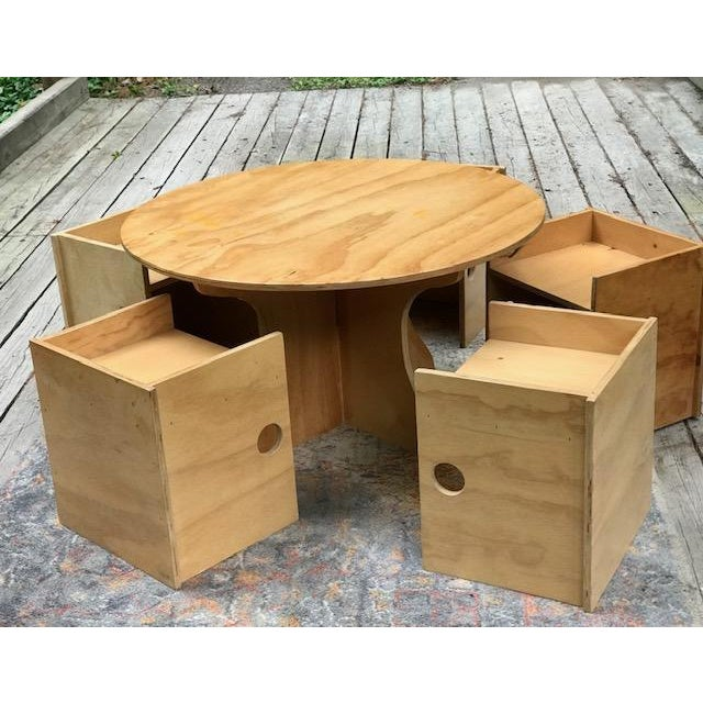 This Artisan made kids table and box chair set consists of six box chairs that can be inverted to use as cubbies and a...