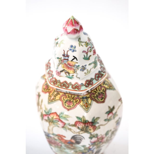 This decorative pair of porcelain jars is adorned with roosters and flowers. Originated from China, circa 1950.
