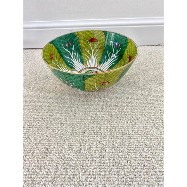 Large vibrant green decorative bowl. Features alternating green colors and gilded detailing along with plums and...