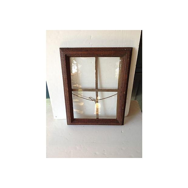 Turn of the century, hand-crafted Tramp Art frame with original old wavy glass. Update this antique frame with a new...