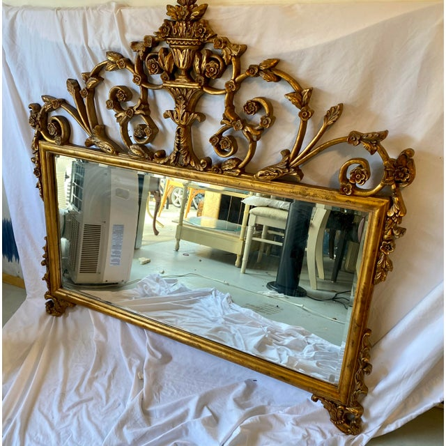 Lovely French Style Giltwood Carved vintage beveled mirror with floral motif. In excellent condition and ready to hang....