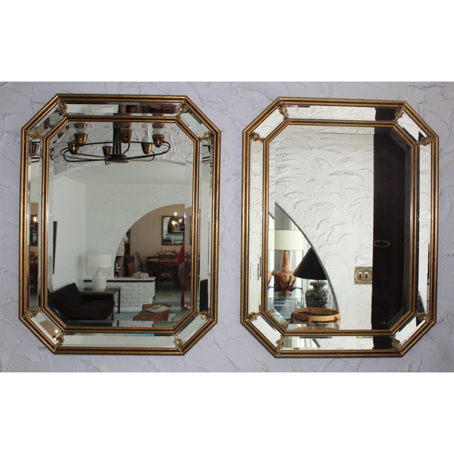 1950s Italian gilt octagonal mirrors with brass detail and beveled mirror.