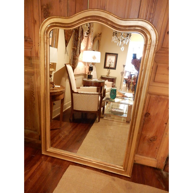 Beautiful wavy shaped top Louis Philippe gold gilt mirror.