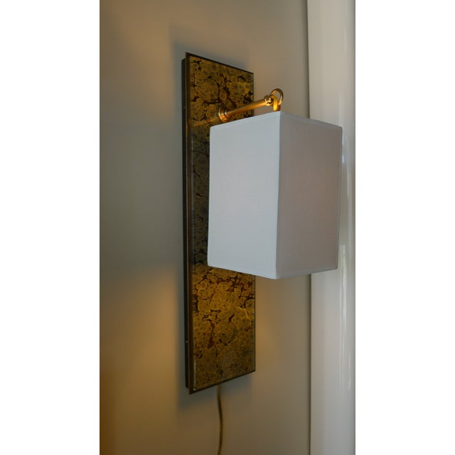 Modern Brass and Marbleized Wall Sconce by Paul Marra. Glass over the marbleized paper. Brass. Paper shade is shown. By...