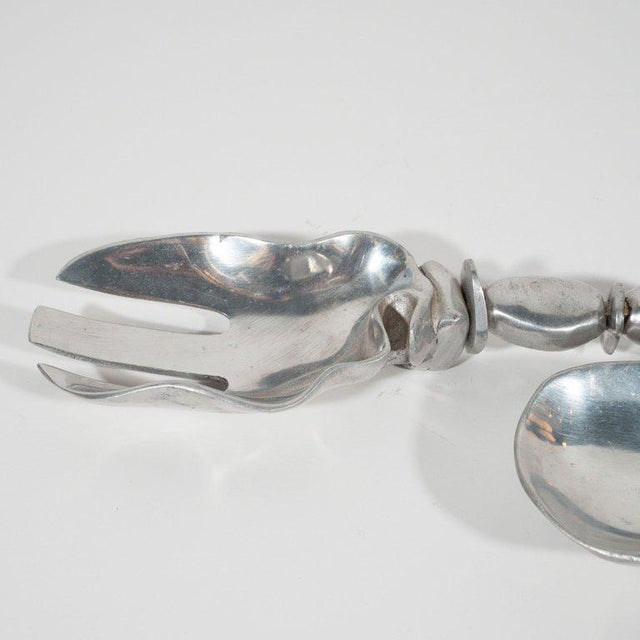 This sophisticated serving set or salad tongs were realized by the esteemed Mid-Century Modern designer Arthur Court,...