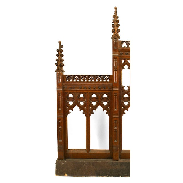 Pair of 19th century English Gothic Revival oak carved railing panels with open design and finials.