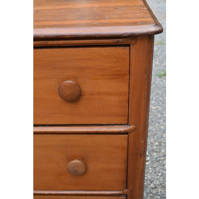 This is an awesome dark pine chest of drawers from the late 19th century. I believe it to be English. Early pin & cove, or...