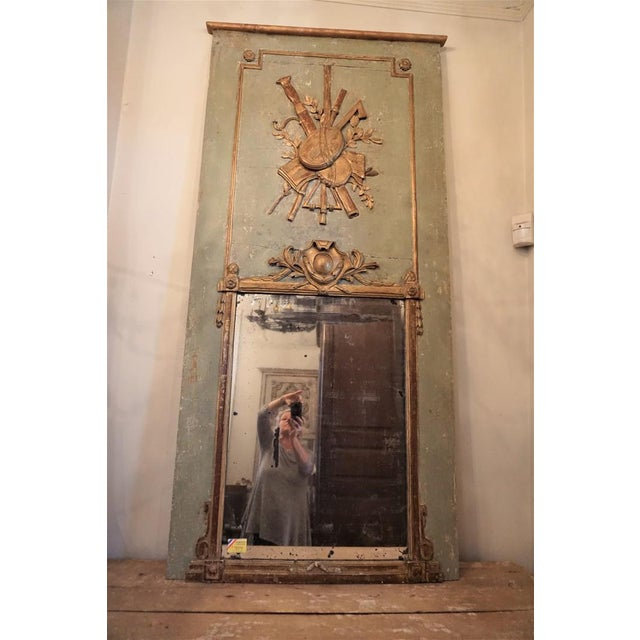 18th Century French period trumeau mirror. Painted in pale green with the traditional gilded musical cartouche. Some minor...