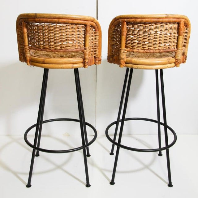 Vintage wrought iron swivel base rattan wicker bar stools. Black coated iron a frame built of 4 tall very thin round...